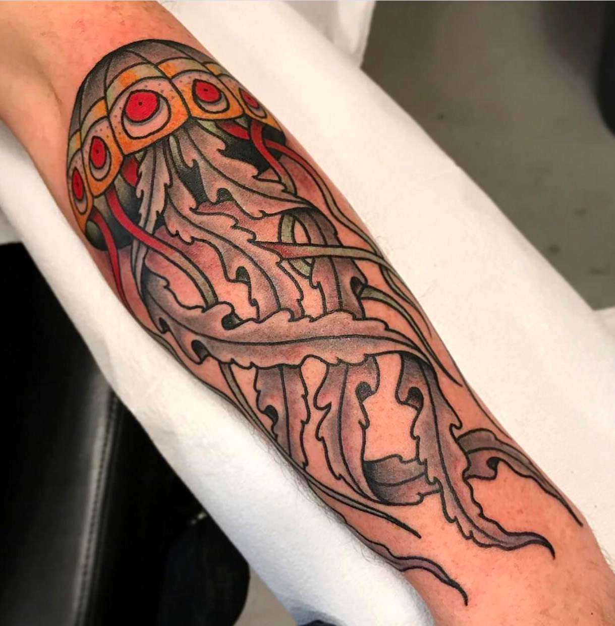 Jellyfish done by zach roman at black moon tattoo in for Tattoo madison wi